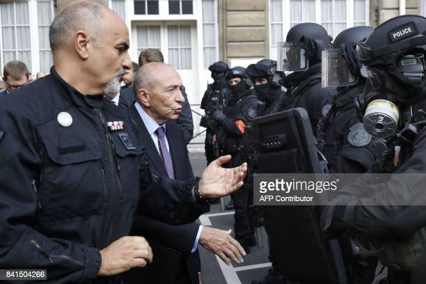 French Interior Minister Gerard Collomb speaks with members of the Research and Intervention Brigade of the French national police next to BRI deputy...