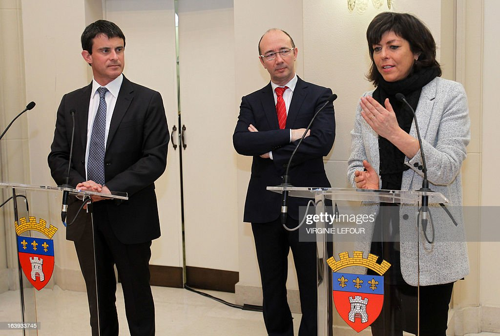 French Interior Minister Manuel Valls (L) and Belgian Vice Prime Minister and Interior Minister Joelle Milquet (R) give a press conference on March 18, 2013 before Walloon and French Community Minister-President Rudy Demotte (C) during the signing and presentation in Tournai of a new police and customs cooperation agreement between the two countries. AFP PHOTO / BELGA / VIRGINIE LEFOUR - BELGIUM OUT -