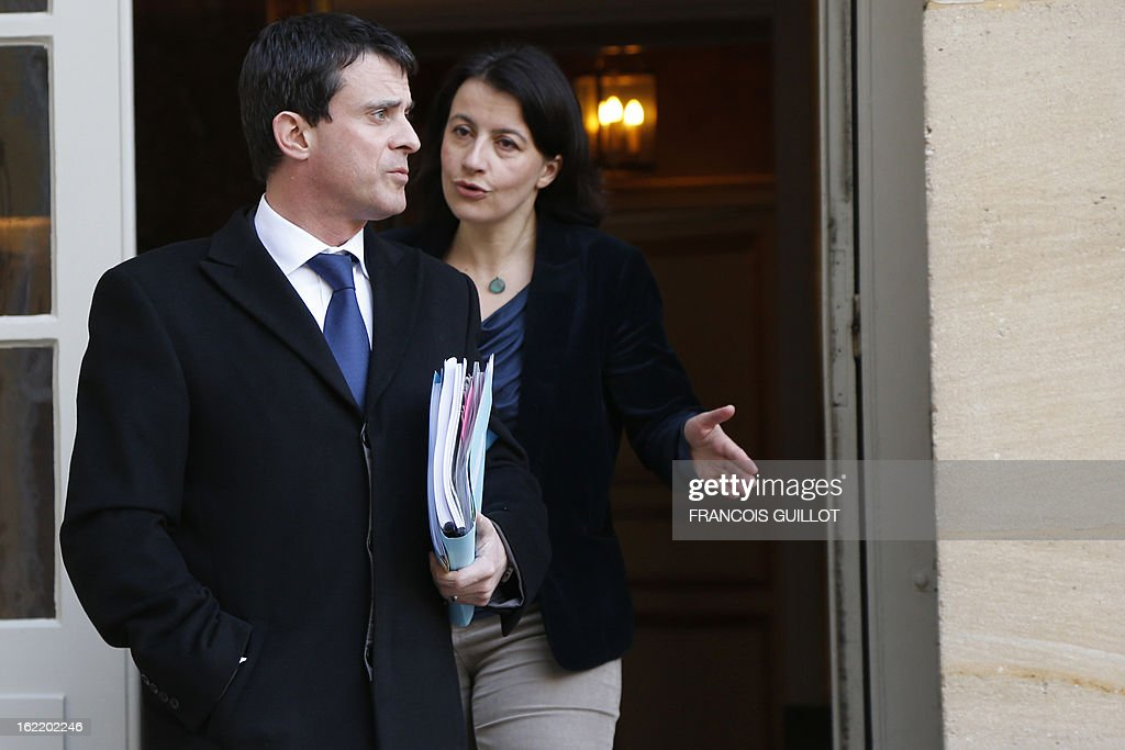 French Interior minister Manuel Valls (R) and French Housing and Territories equality minister Cecile Duflot leave following a lunch with French Prime Minister and French government's ministers focused on budget on February 20, 2013 at the Hotel Matignon, the Prime Minister official residence, in Paris.