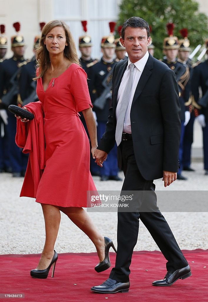 French Interior Minister Manuel Valls (R) and his wife Anne Gravoin arrive at the Elysee presidential palace, in Paris, on September,3, 2013, for a State dinner with the French and German presidents.
