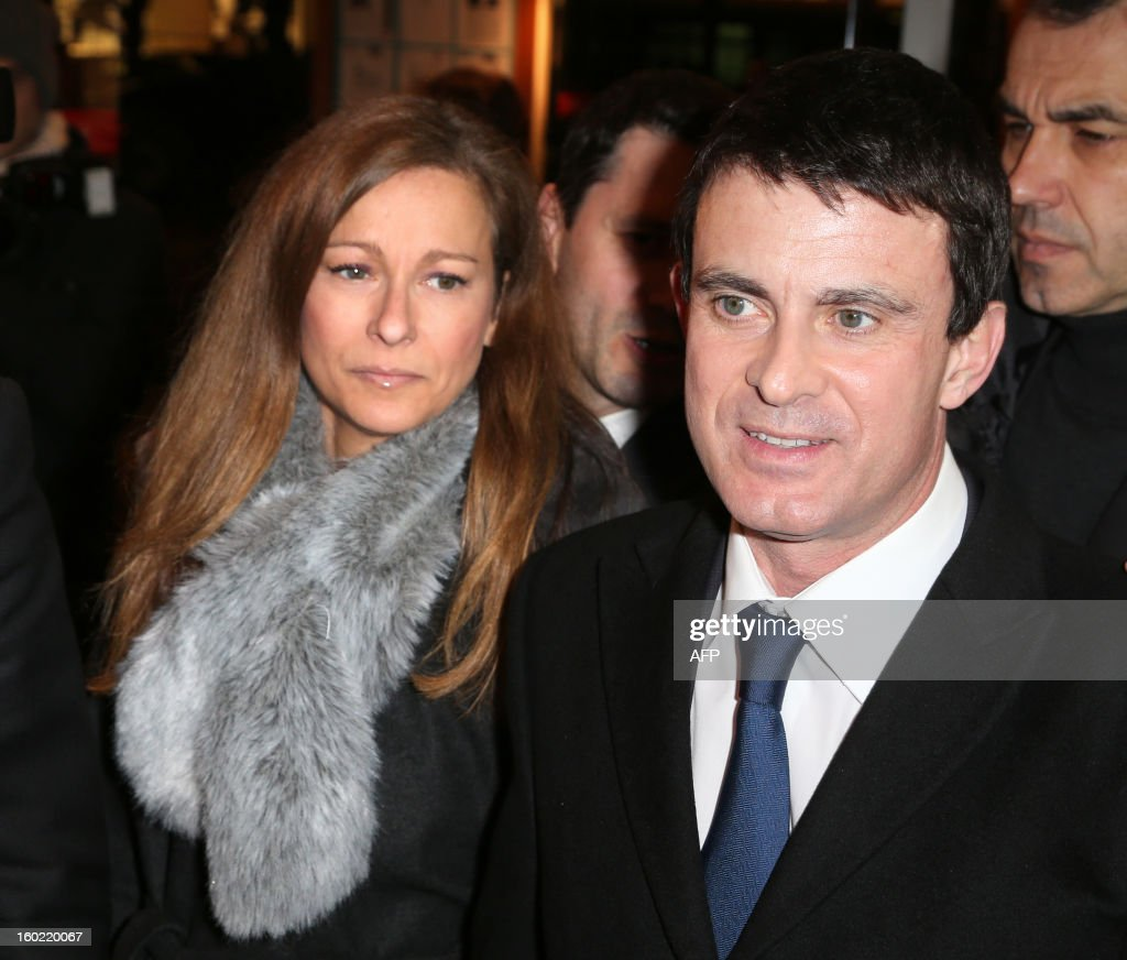 French Interior minister Manuel Valls and his wife Anne Gravoin arrive for a special event gathering artists and celebrities in support of French government plans to legalise gay marriage and same-sex adoption on January 27, 2013 in Paris, two days before parliament takes up the text, which has been met with strong opposition from the right and the Catholic Church. AFP PHOTO / THOMAS SAMSON