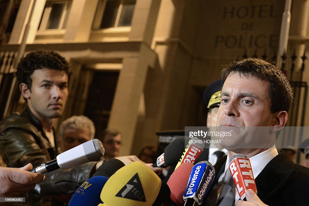French Interior Minister Manuel Valls answers journalists' questions after a meeting with local police representatives on November 26, 2012 in Marseille, southeastern France, after a 47-year old man was shot dead today by two unidentified people who stole his briefcase. AFP PHOTO / BORIS HORVAT