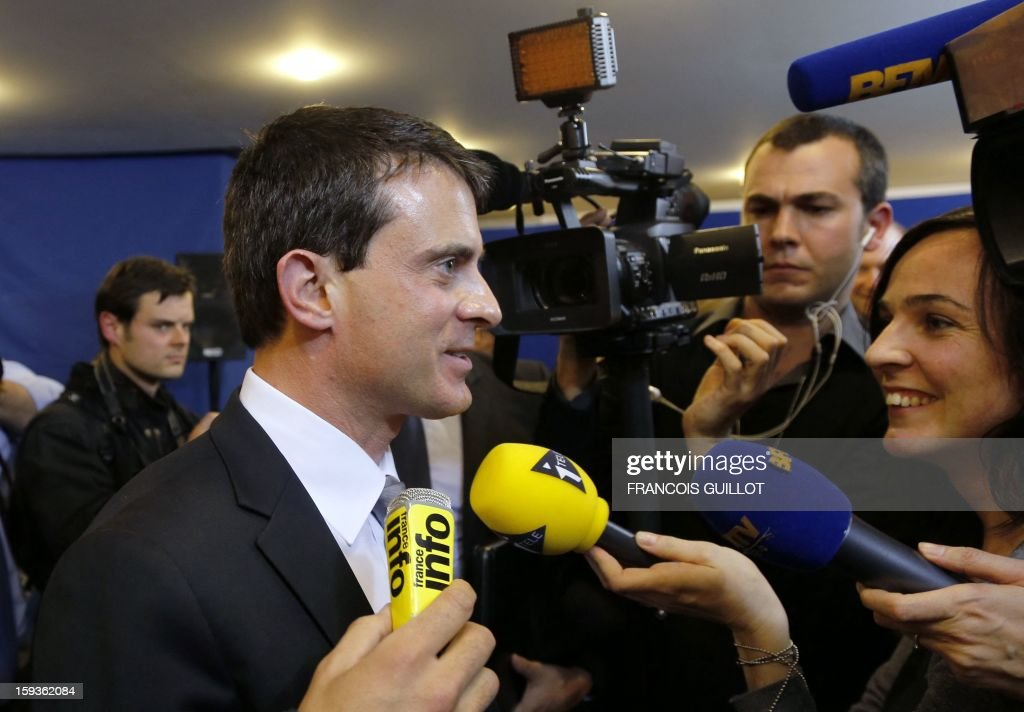 French Interior Minister Manuel Valls (C) answers journalists' questions during his visit to the central office of the IT and cyber crime police unit (known in French as the O.C.L.C.T.I.C.), on January 11, 2013 in Nanterre, outside Paris.