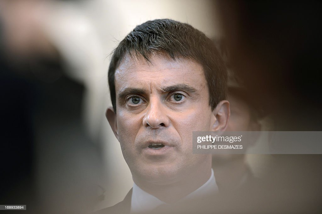 French Interior Minister Manuel Valls answers journalists' questions on May 17, 2013 in Annemasse after his visit to a police station in a priority areas of critical security (ZSP). AFP PHOTO/PHILIPPE DESMAZES