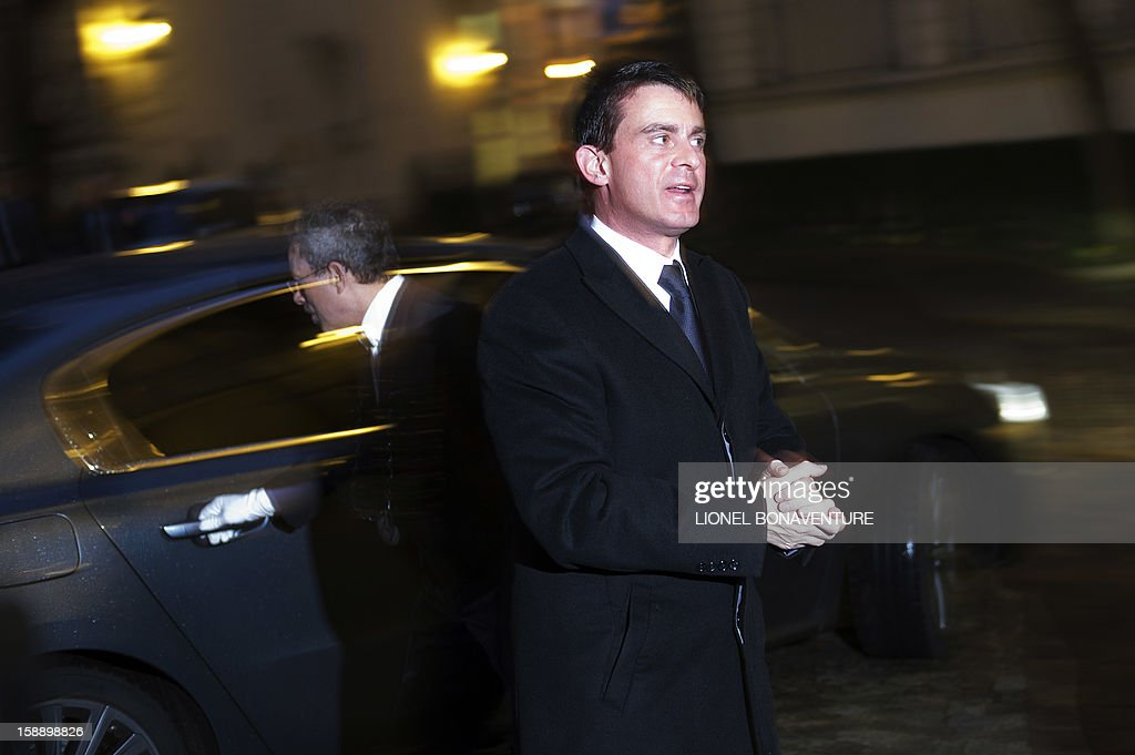 French Interior Minister Manuel Valls arrives at his ministry to attend a breakfast with ministers on January 3, 2013 in Paris, prior to first cabinet meeting of the year. AFP PHOTO LIONEL BONAVENTURE