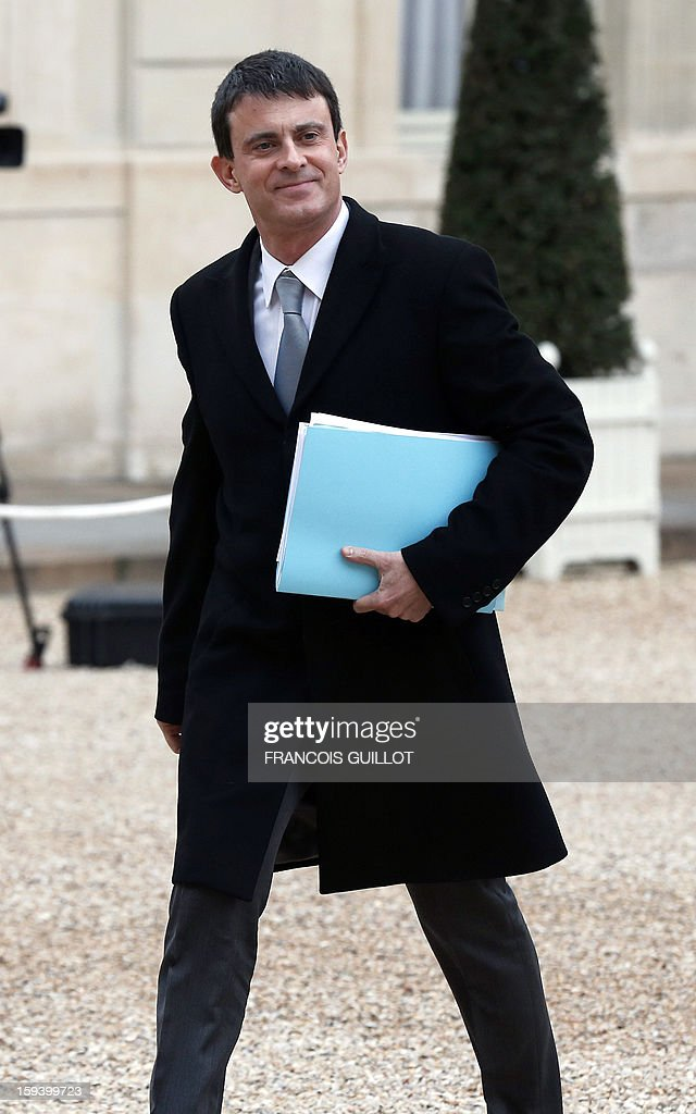 French Interior minister Manuel Valls arrives at the Elysee presidential palace on January 13, 2013 in Paris to take part in a defence council focused on the situation in Mali. French forces carried out airstrikes in Mali today for a third straight day and extended their bombing campaign to the northern strongholds of Islamist forces they are trying to drive out of the centre of the country.