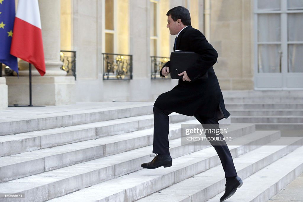 French Interior Minister Manuel Valls arrives at the Elysee Presidential palace in Paris for a meeting with French President focused on the situation in Mali and Algeria on January 18, 2013. Two French workers 'are back' safe from the hostage crisis in Algeria, Interior Minister Manuel Valls said today, adding that 'very few' were working at the gas plant at the time of the attack.