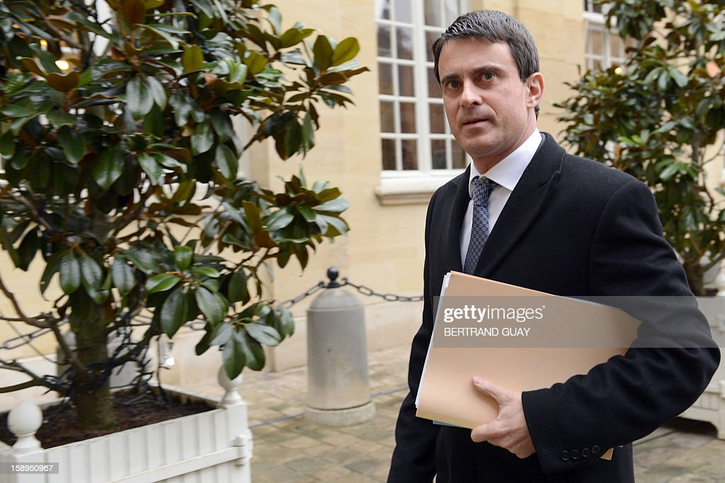 French Interior Minister, Manuel Valls arrives to take part in a government seminar focusing on the government's agenda for the coming year on January 4, 2013 at the Hotel Matignon in Paris.