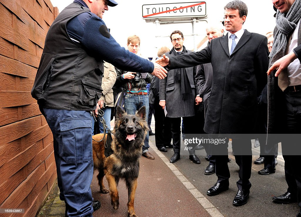 French Interior Minister Manuel Valls (R) attends a road traffic control on March 18, 2013 near the border in Tourcoing, northern France, as part of a Franco-Belgian cooperation agreement between police and customs.