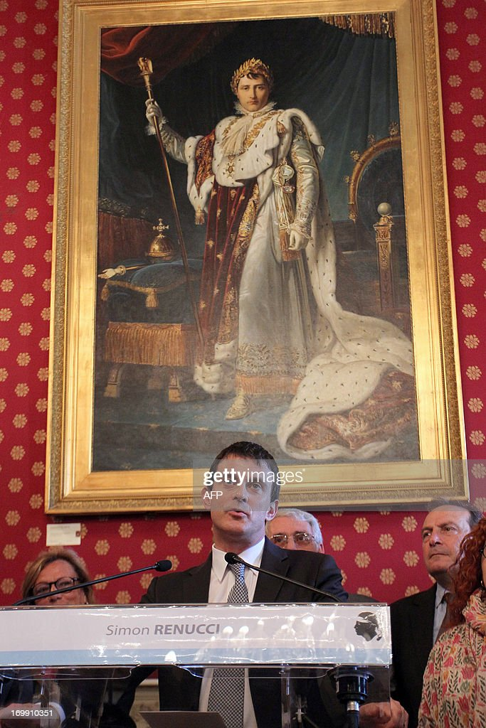 French Interior Minister Manuel Valls delivers a speech at the Ajaccio town hall, with a painting of Napoleon in the background, on June 4, 2013, in Ajaccio, on the French Mediterranean Island of Corsica.