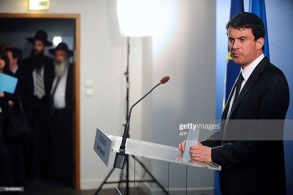 French Interior Minister Manuel Valls delivers a speech before paying homage, on March 19, 2013, in the 'Espace du judaisme' in Toulouse, southwestern France, to those slain by Al-Qaeda-inspired gunman Mohamed Merah whose shooting spree in and around Toulouse left seven people dead in March 2012. GABALDA