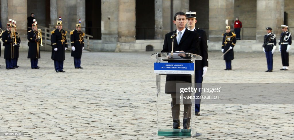 French Interior minister Manuel Valls delivers a speech during a memorial cemerony honoring French gendarmes who died during service, on February 18, 2013 at the Hotel des Invalides in Paris.