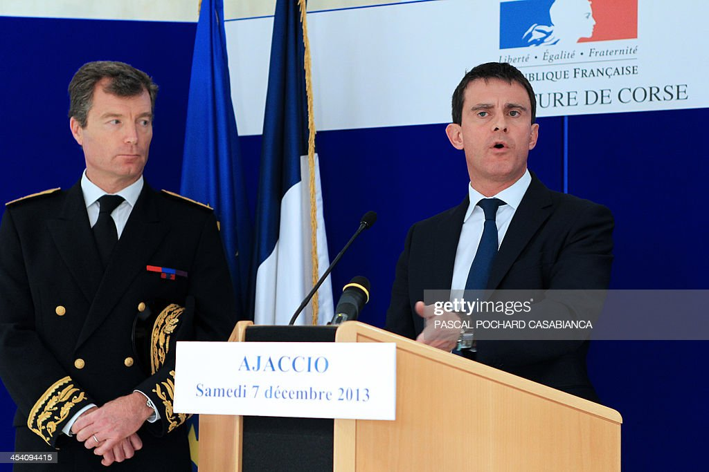 French Interior minister Manuel Valls (R) delivers a speech next to Southtern Corsica Prefect Christophe Mirmand (L), during a visit at the Ajaccio's gendarmerie station two days after the building was hit by rockets, on December 7, 2013 in the French Mediterranean island of Corsica.
