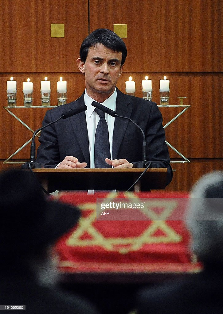 French Interior Minister Manuel Valls delivers a speech on March 19, 2013, in the 'Espace du judaisme' in Toulouse, southwestern France, in memory of those slain by Al-Qaeda-inspired gunman Mohamed Merah whose shooting spree in and around Toulouse left seven people dead in March 2012. .