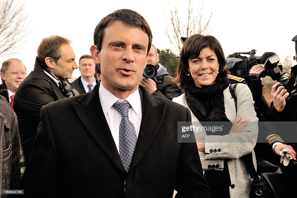 French Interior Minister Manuel Valls (L) flanked by Belgian Vice Prime and Interior Minister Joelle Milquet attend a road traffic control on March 18, 2013 near the border in Tourcoing, northern France, as part of a Franco-Belgian cooperation agreement between police and customs.