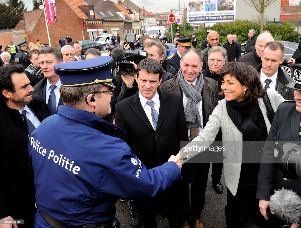 French Interior Minister Manuel Valls (C) flanked by Belgian Vice Prime and Interior Minister Joelle Milquet (R) attend a road traffic control on March 18, 2013 near the border in Tourcoing, northern France, as part of a Franco-Belgian cooperation agreement between police and customs.