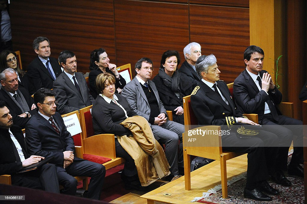 French Interior Minister Manuel Valls (R) flanked by Midi-Pyrenees region prefect and Haute-Garonne department prefect Henri-Michel Comet (2ndR) listens to speeches during an homage at the 'Espace du judaisme' in Toulouse, southwestern France, to those slain by Al-Qaeda-inspired gunman Mohamed Merah whose shooting spree in and around Toulouse left seven people dead in March 2012. GABALDA