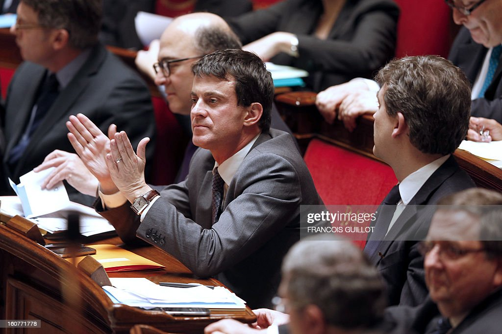 French Interior Minister Manuel Valls gestures as he takes part in a session of questions to the government at the National Assembly on February 5, 2013 in Paris. AFP PHOTO FRANCOIS GUILLOT