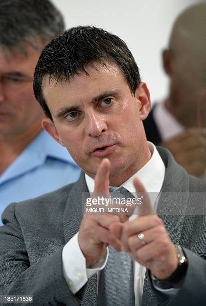 French Interior Minister Manuel Valls gestures during a visit at the 'Frantz Fanon' school on October 17 2013 in La Trinite on the French Caribbean...