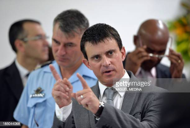 French Interior Minister Manuel Valls gestures during a visit to the 'Frantz Fanon' school on October 17 2013 in La Trinite on the French Caribbean...