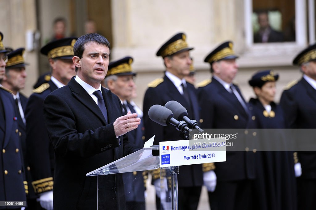 French Interior minister Manuel Valls gives a speech during a tribute to late prefect Claude Erignac, 15 years after he was murdered, on February 6, 2013 at the Interior ministry in Paris. Erignac, 60, the state-appointed 'prefect' or governor of Corsica, was shot three times in the back of the head as he walked to a concert hall in Corsica's capital Ajaccio on February 5, 1998, the most spectacular attack in some 30 years of separatist violence. AFP PHOTO / MEHDI FEDOUACH