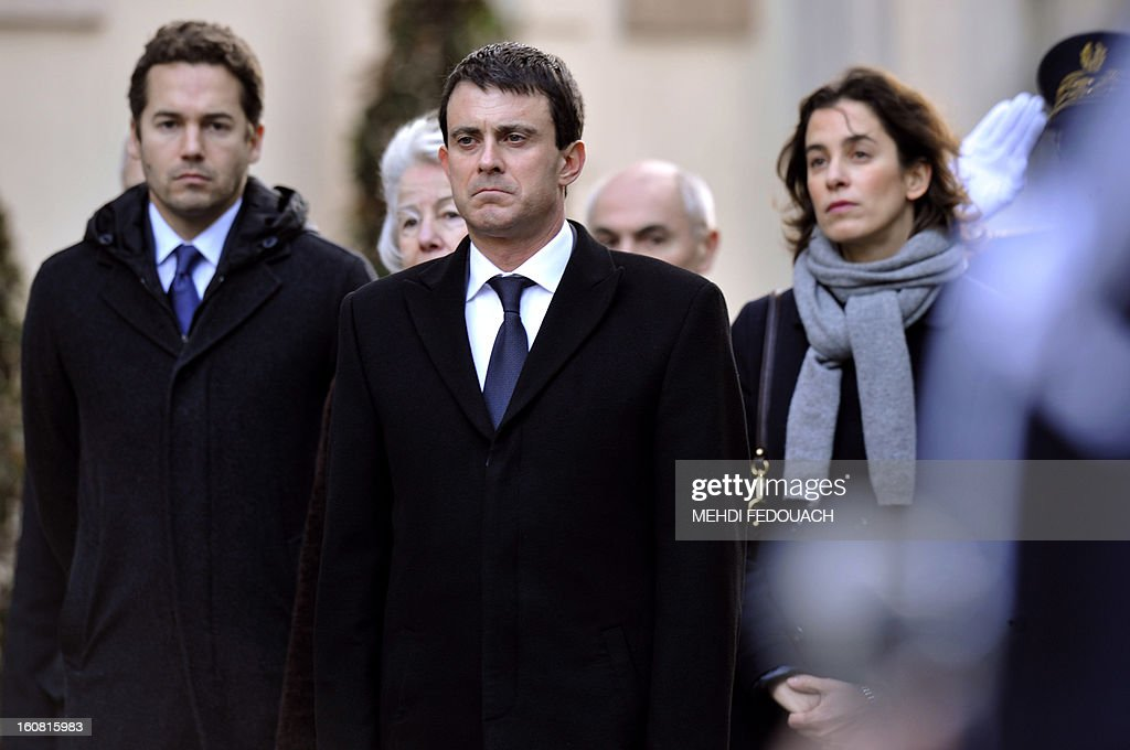 French Interior minister Manuel Valls (R) is followed by late prefect Claude Erignac's childern during a tribute ceremony 15 years after he was murdered, on February 6, 2013 at the Interior ministry in Paris. Erignac, 60, the state-appointed 'prefect' or governor of Corsica, was shot three times in the back of the head as he walked to a concert hall in Corsica's capital Ajaccio on February 5, 1998, the most spectacular attack in some 30 years of separatist violence.