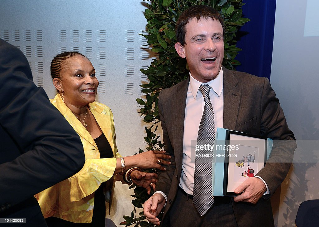 French Interior Minister, Manuel Valls (R) jokes with French Justice Minister Christiane Taubira as they attend the annual congress of the Union Syndicale des Magistrats (union association of magistrates), in Colmar, eastern France, on October 19, 2012.