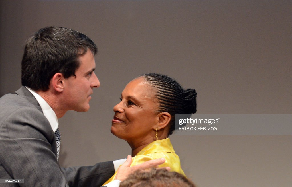 French Interior Minister, Manuel Valls (L) jokes with French Justice Minister Christiane Taubira as they attend the annual congress of the Union Syndicale des Magistrats (union association of magistrates), in Colmar, eastern France, on October 19, 2012. AFP PHOTO / PATRICK HERTZOG