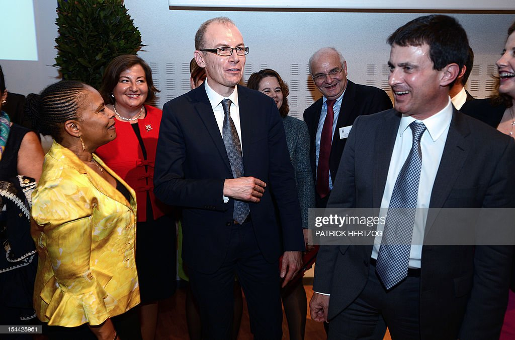 French Interior Minister, Manuel Valls (R) jokes with French Justice Minister Christiane Taubira and the president of the Union Syndicale des Magistrats Christophe Regnard (C) as they take part in the annual congress of the Union Syndicale des Magistrats (union association of magistrates), in Colmar, eastern France, on October 19, 2012.