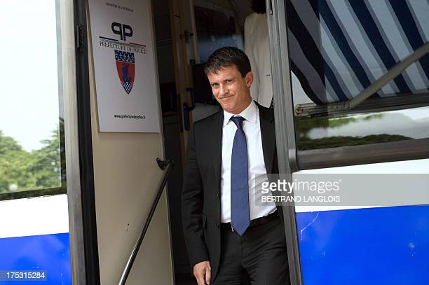 French Interior Minister Manuel Valls leaves a bus as he verifies security measures taken to protect tourists around the Eiffel Tower area on August...