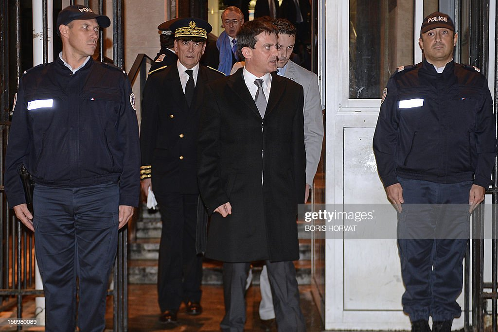 French Interior Minister Manuel Valls (C) leaves after a meeting with local police representatives on November 26, 2012 in Marseille, southeastern France, after a 47-year old man was shot dead today by two unidentified people who stole his briefcase.