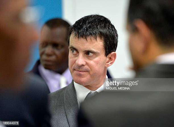 French Interior Minister Manuel Valls looks on during a visit to the 'Frantz Fanon' school on October 17 2013 in La Trinite on the French Caribbean...