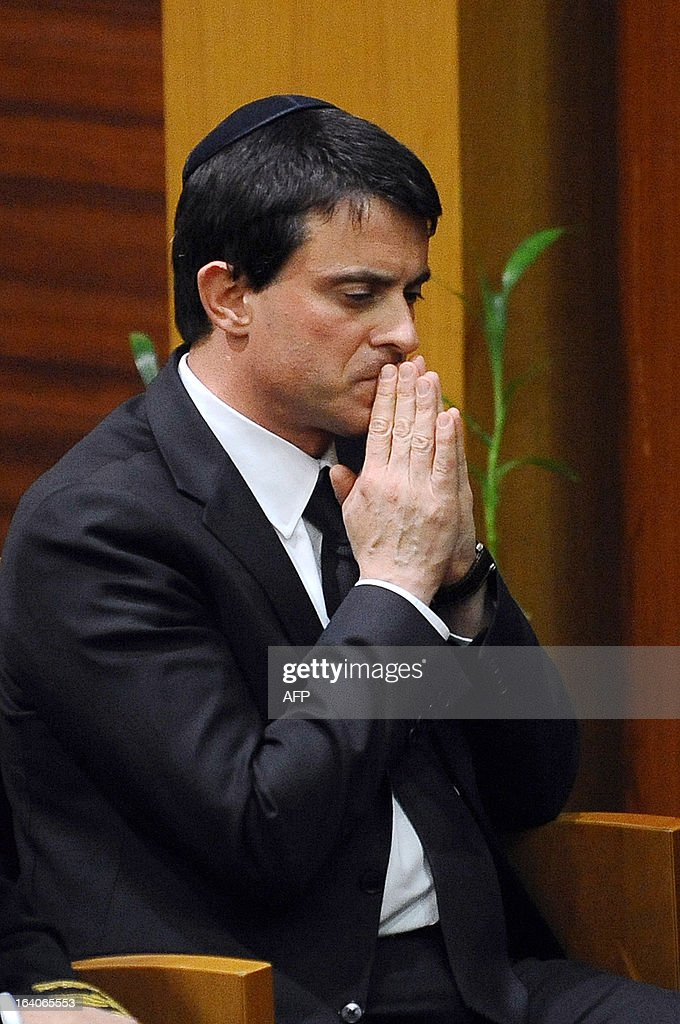 French Interior Minister Manuel Valls pays homage, on March 19, 2013, in the 'Espace du judaisme' in Toulouse, southwestern France, to those slain by Al-Qaeda-inspired gunman Mohamed Merah whose shooting spree in and around Toulouse left seven people dead in March 2012. GABALDA