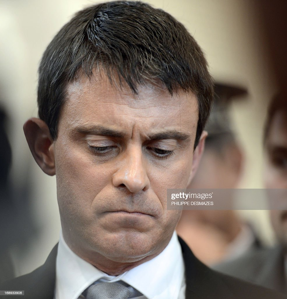 French Interior Minister Manuel Valls reacts during a press conference on May 17, 2013 in Annemasse after his visit to a police station in a priority areas of critical security (ZSP).