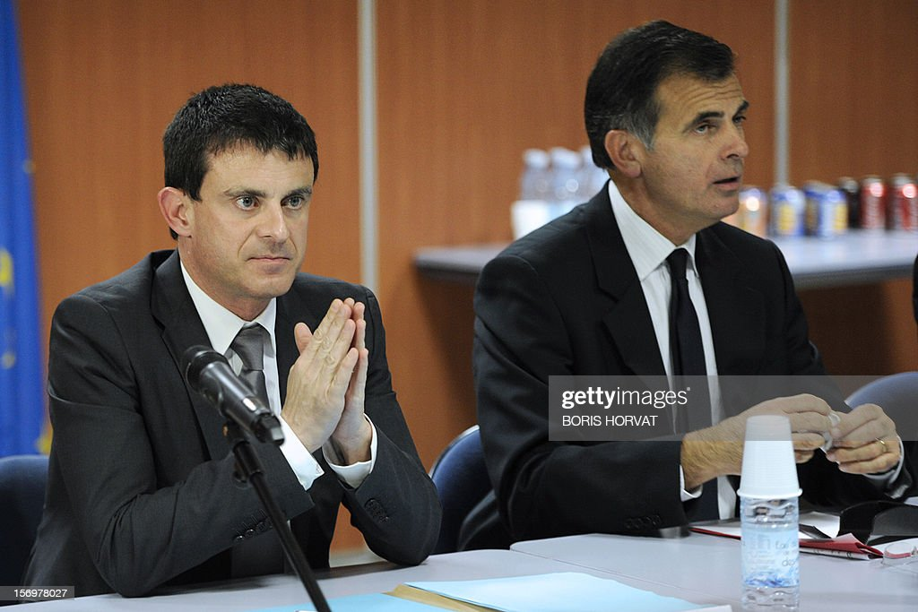 French Interior Minister Manuel Valls sits near prosecutor Jacques Dallest during a meeting with local police representatives on November 26, 2012 in Marseille, southeastern France, after a 47-year old man was shot dead today by two unidentified people who stole his briefcase.