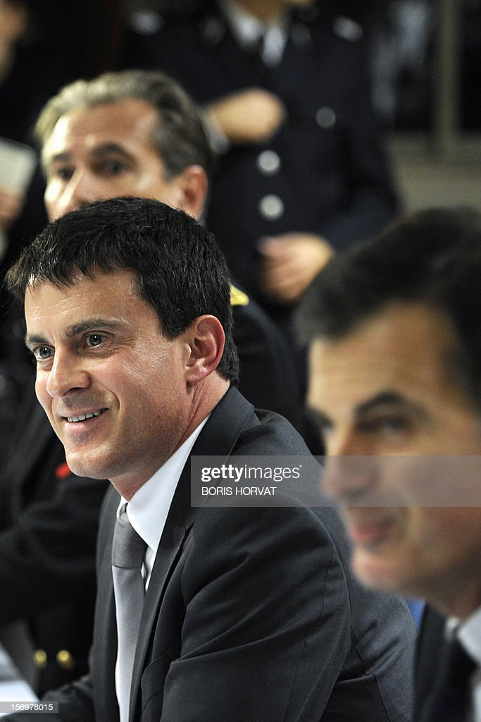 French Interior Minister Manuel Valls smiles during a meeting with local police representatives on November 26, 2012 in Marseille, southeastern France, after a 47-year old man was shot dead today by two unidentified people who stole his briefcase.
