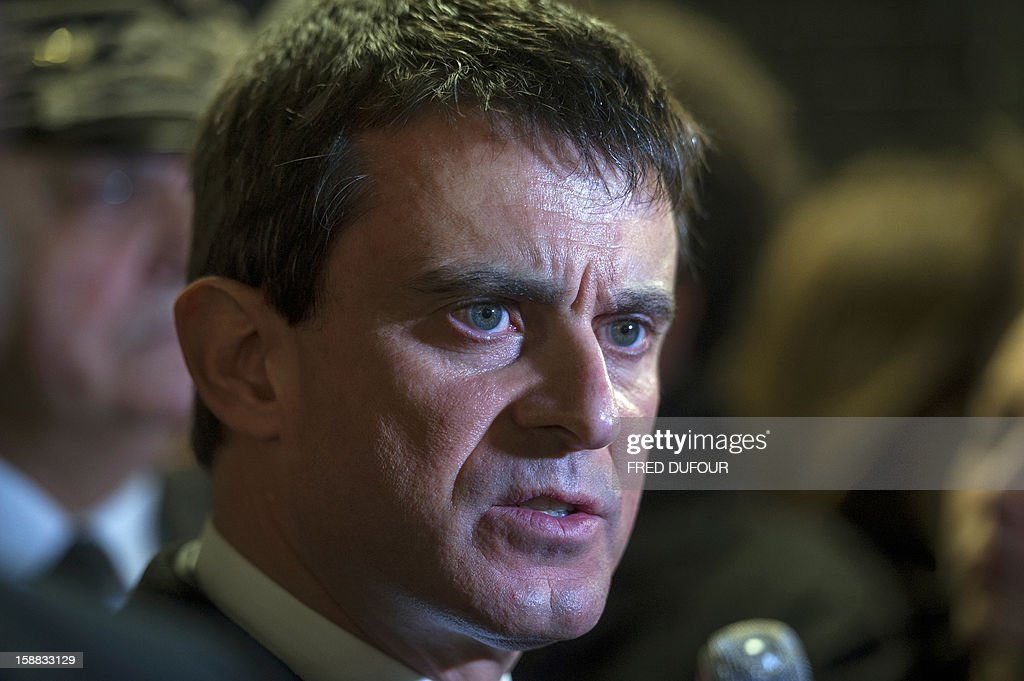 French Interior Minister Manuel Valls speaks to the press as he visits the security staff at the Charles de Gaulle airport on December 31, 2012 in Roissy. AFP PHOTO FRED DUFOUR