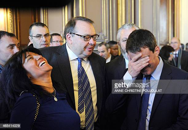 French Interior Minister Manuel Valls speaks with Socialist party's candidate for the 2014 mayoral election in Marseille Patrick Mennucci and French...