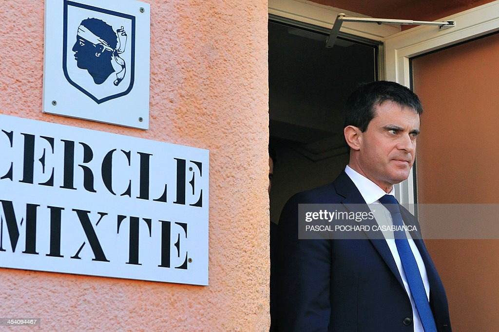 French Interior minister Manuel Valls visits the Ajaccio's gendarmerie station two days after the building was hit by rockets, on December 7, 2013 in the French Mediterranean island of Corsica.