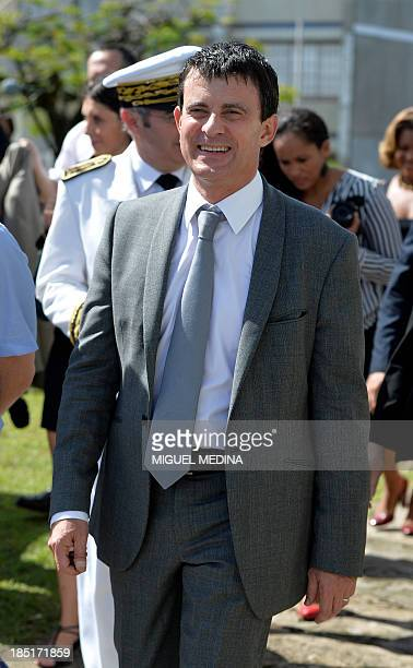 French Interior Minister Manuel Valls visits the 'Frantz Fanon' school on October 17 2013 in La Trinite on the French Caribbean island of Martinique...