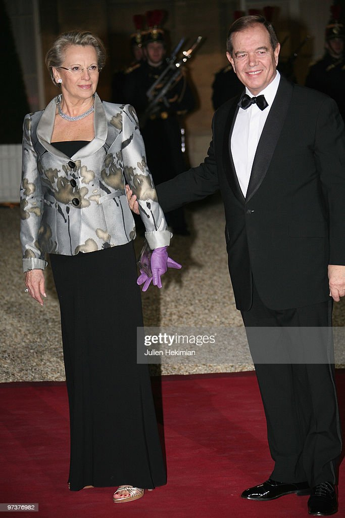 French Interior Minister Michelle Alliot-Marie (L) arrives with husband to attend a state dinner at Elysee Palace on March 2, 2010 in Paris, France.