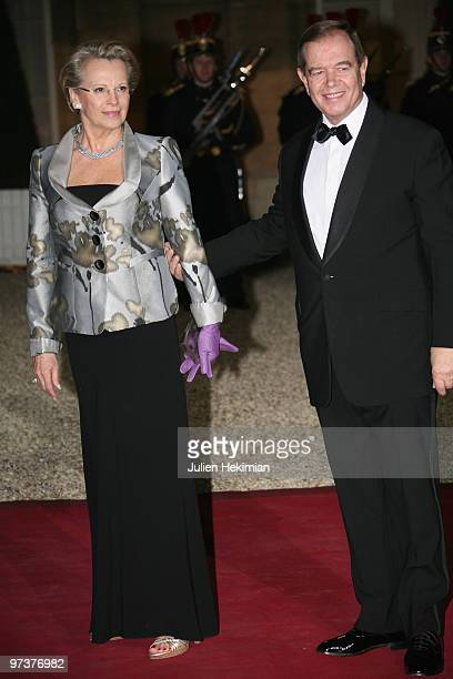 French Interior Minister Michelle AlliotMarie arrives with husband to attend a state dinner at Elysee Palace on March 2 2010 in Paris France