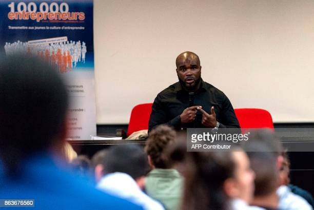 French Interministerial Delegate for Equal Opportunities for Overseas French Citizens and former boxer JeanMarc Mormeck delivers a speech to pupils...
