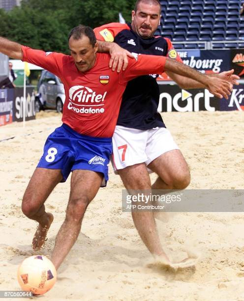 French international Eric Cantona challenges for the ball in the match between France and Spain in the the British leg of the Kronenburg beach...
