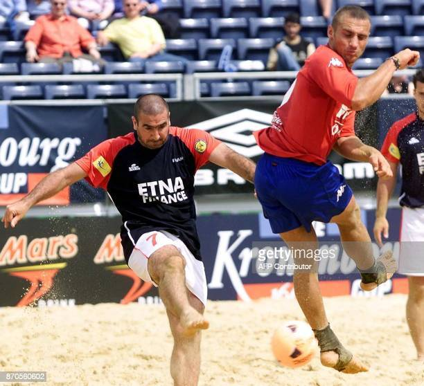 French international Eric Cantona scores from the kick off in the match between France and Spain in the the British leg of the Kronenburg beach...