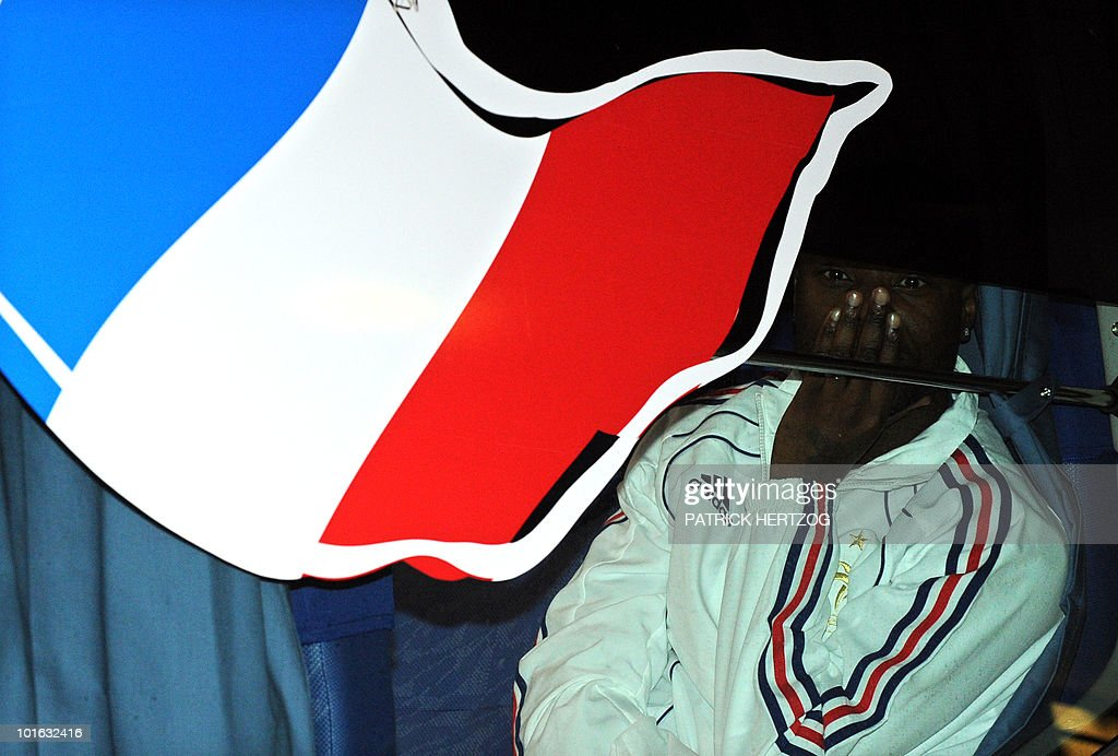 French international football defender William Gallas looks through the window of the team bus as the French team arrive at George Airport on June 5, 2010. The FIFA 2010 World Cup begins on June 11, 2010.