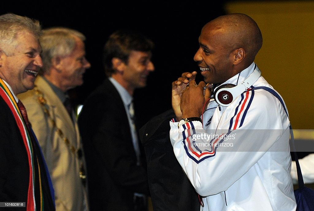 French international football forward Thierry Henry (R) smiles as he greets fans upon the arrival of the French team at George Airport on June 5, 2010. The FIFA 2010 World Cup begins on June 11, 2010.