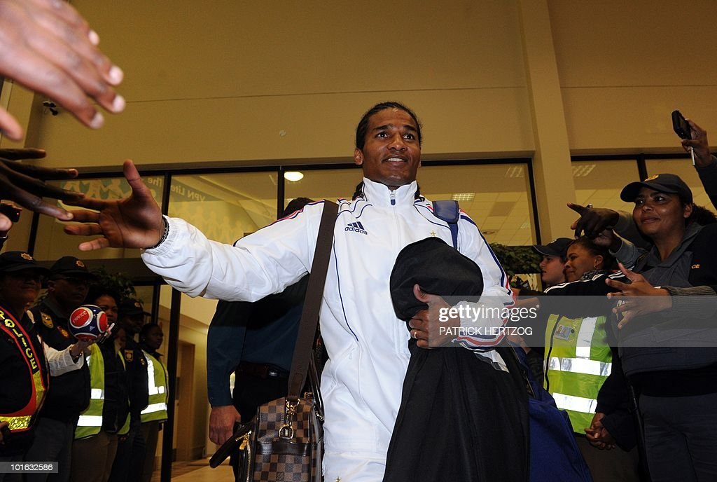 French international football midfielder Florent Malouda greets fans as he arrives with teh French team at George Airport on June 5, 2010. The FIFA 2010 World Cup begins on June 11, 2010.