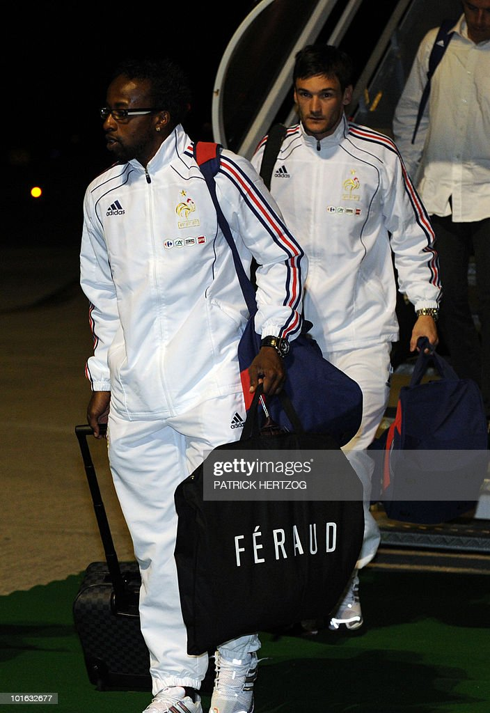 French international football Sidney Govou (L) and Hugo Lloris step off their plane upon the arrival of the French team at George Airport on June 5, 2010. The FIFA 2010 World Cup begins on June 11, 2010.
