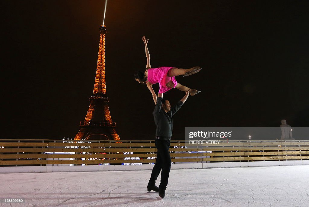 French international ice skater and choreographer, Florentina Houdiniere (top) and French ice skater Nicolas Branne, both working at the Bouglione Circus, perform during the inauguration of the 'Christmas village', on December 13, 2012, in Paris, as part of the 'Trocadero On Ice' event. An ice-skating rink opened to public in front of the Eiffel tower, and will run until January 6, 2013.